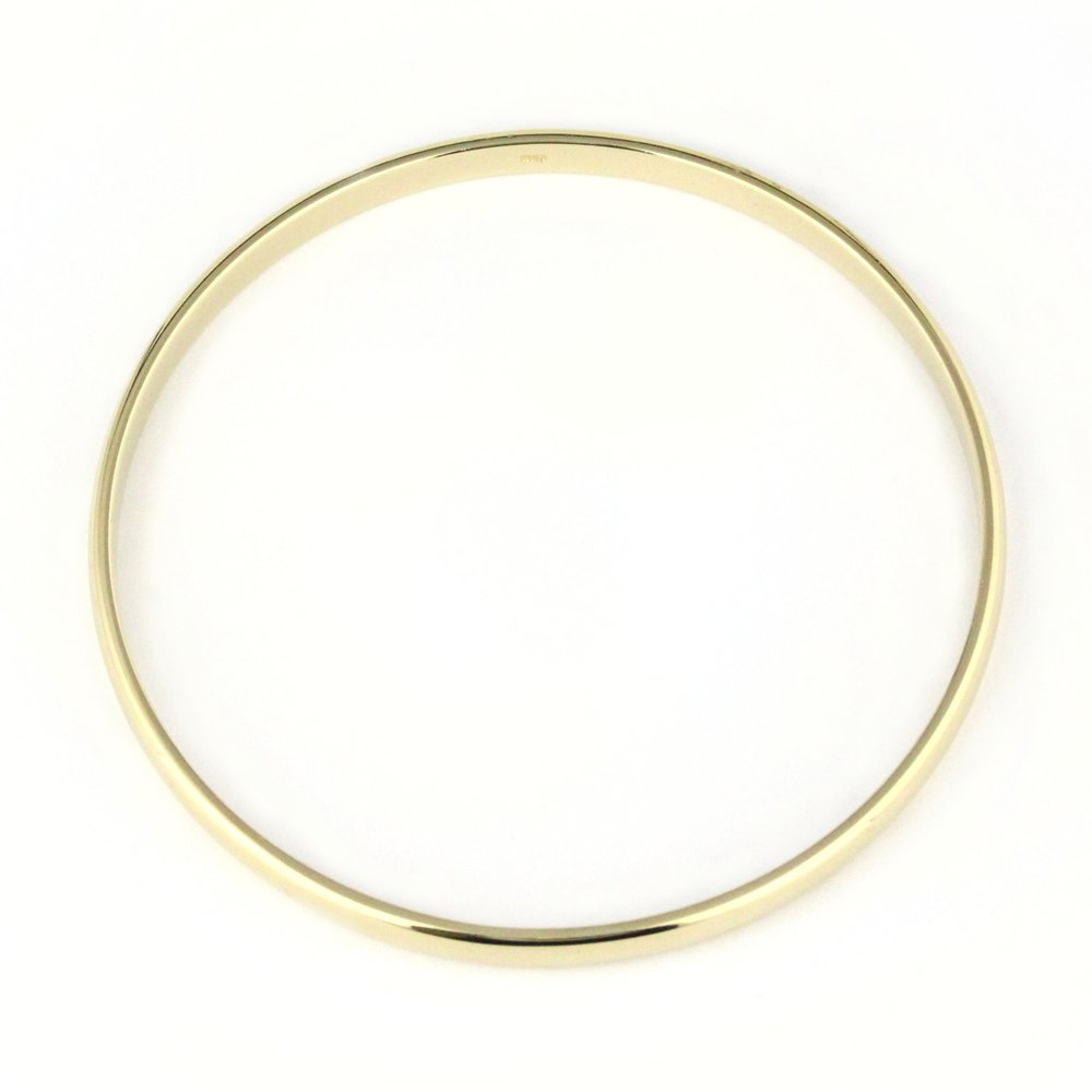 Thin yellow gold half round bangle.