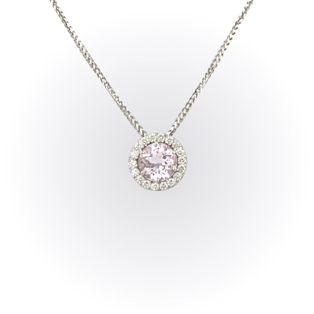 Round morganite with diamond halo pendant set in whtie gold.