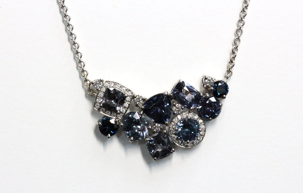 Midsummer Night pendant. Set with a variety of Australian Sapphires, Spinels and highlighted with diamonds.