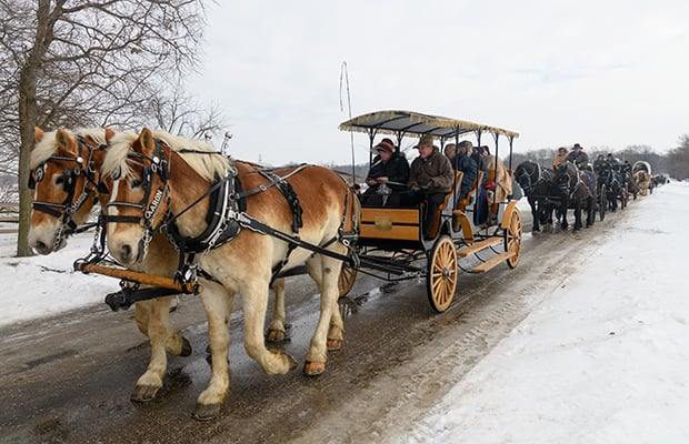 Members and missionaries ride wagons down Main and Parley Streets in Nauvoo to commemorate the 1846 Nauvoo Exodus. Photo courtesy of Bruce Cornwell.