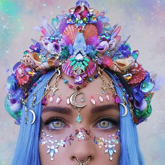 Its like a rainbow, crystal garden an galaxy all got made into the convenience of a single crown.  And that's exactly what it is.. Its hard to see on a photo but this crown has so many crystals and raw crystal rocks!  #brightcolours #mermaidhair #bluehair #mermaidcrown #crystalcrown #galaxy #mooncrown #crystals #seashells #mermaid #rainbow #handmade #mafs