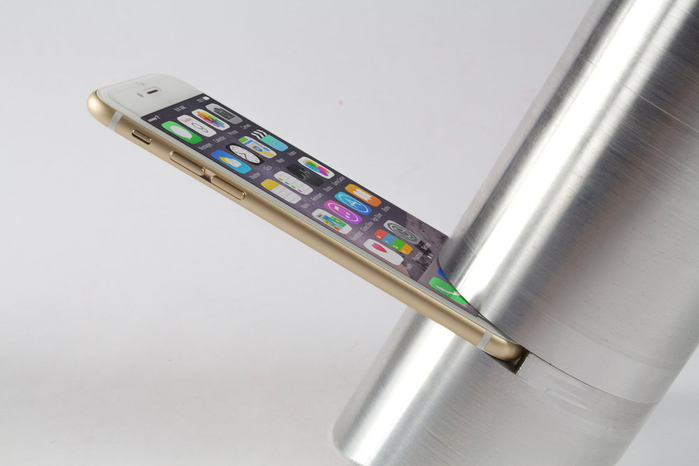 Slit is large enough for a smart phone to slide through. A taper is strategically placed in the larger part of the speaker to amplify sound from the phone as it is released from a phone speaker at the bottom of the device. As sound is released from the phone, it travels upwards into the speaker and is amplified as the taper widens the top of the speaker to naturally amplify sound.