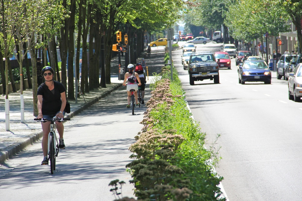 Parking lanes could be converted to bike lanes.
