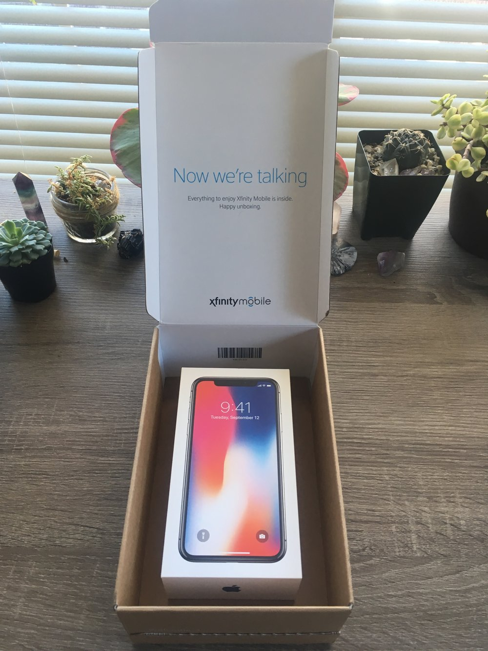 Packaging of the iPhone X by Xfinity mobile. Not shown, instructional card, protective bubble wrap.