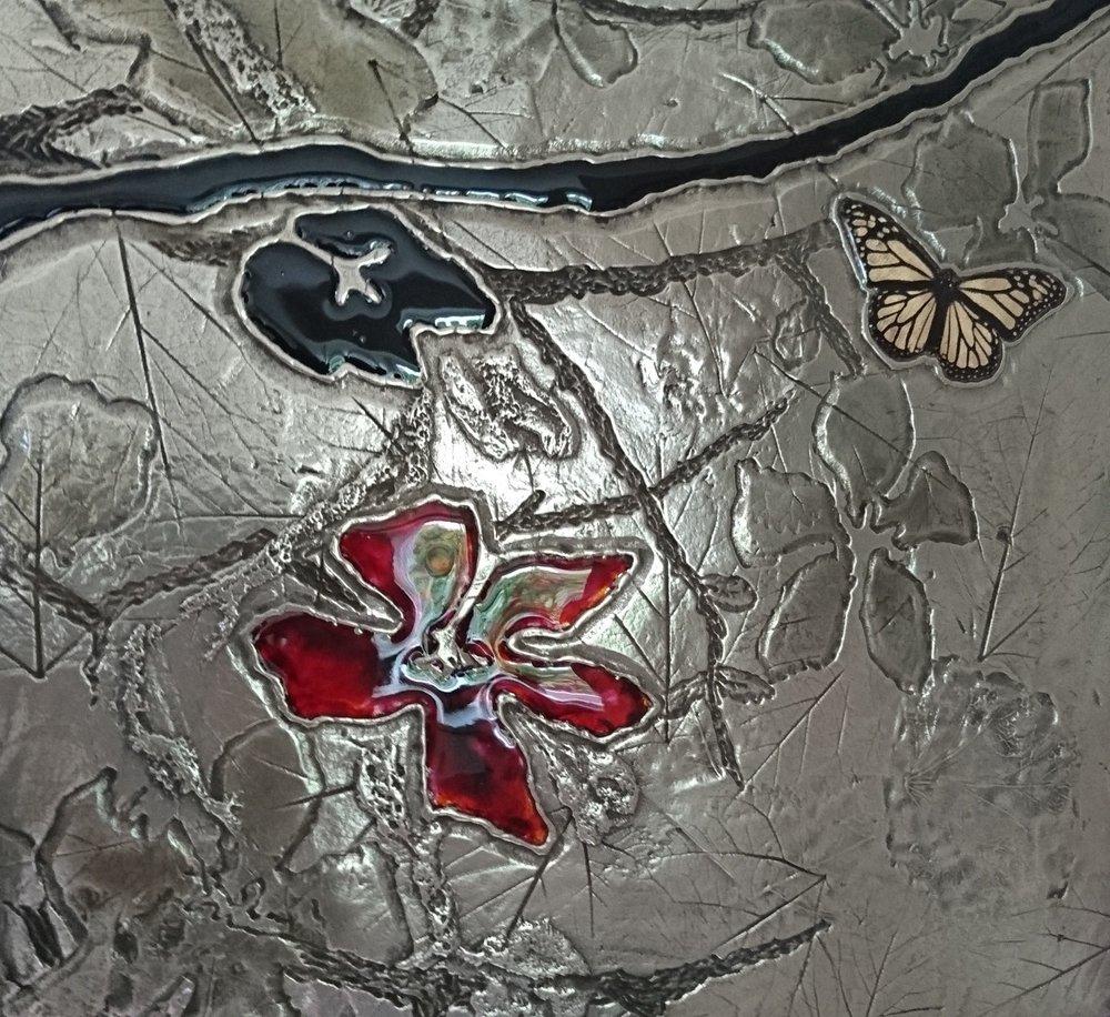 50.Dekoratyvinis pano. Reljefas dengtas platina, stiklu.