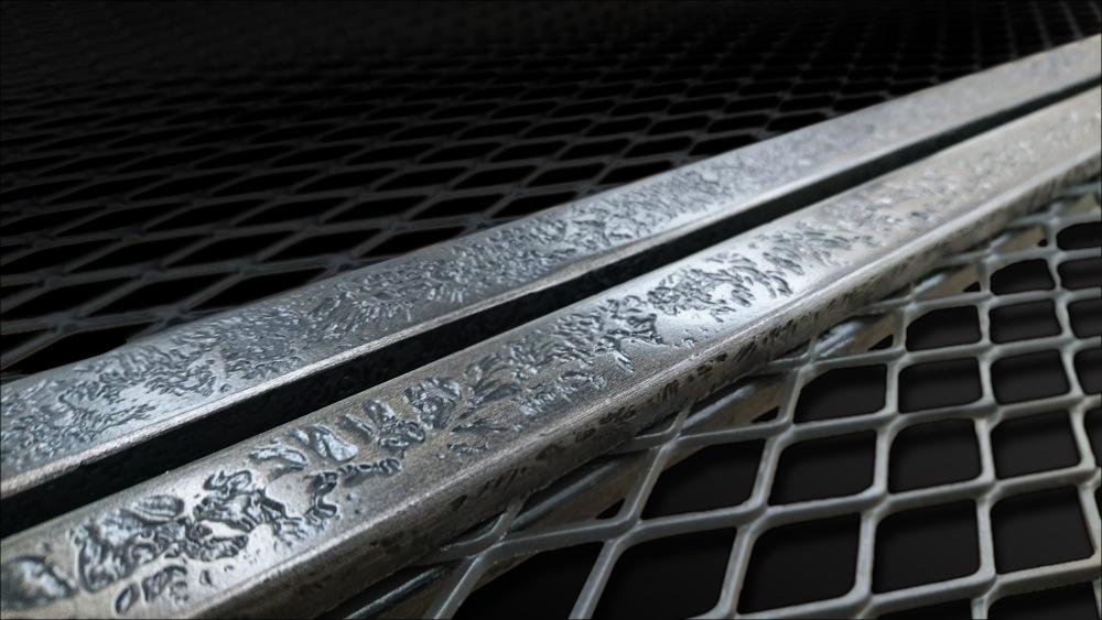 64. Patinuoto metalo reljefas suformuotas ant plieninių baldo durelių.