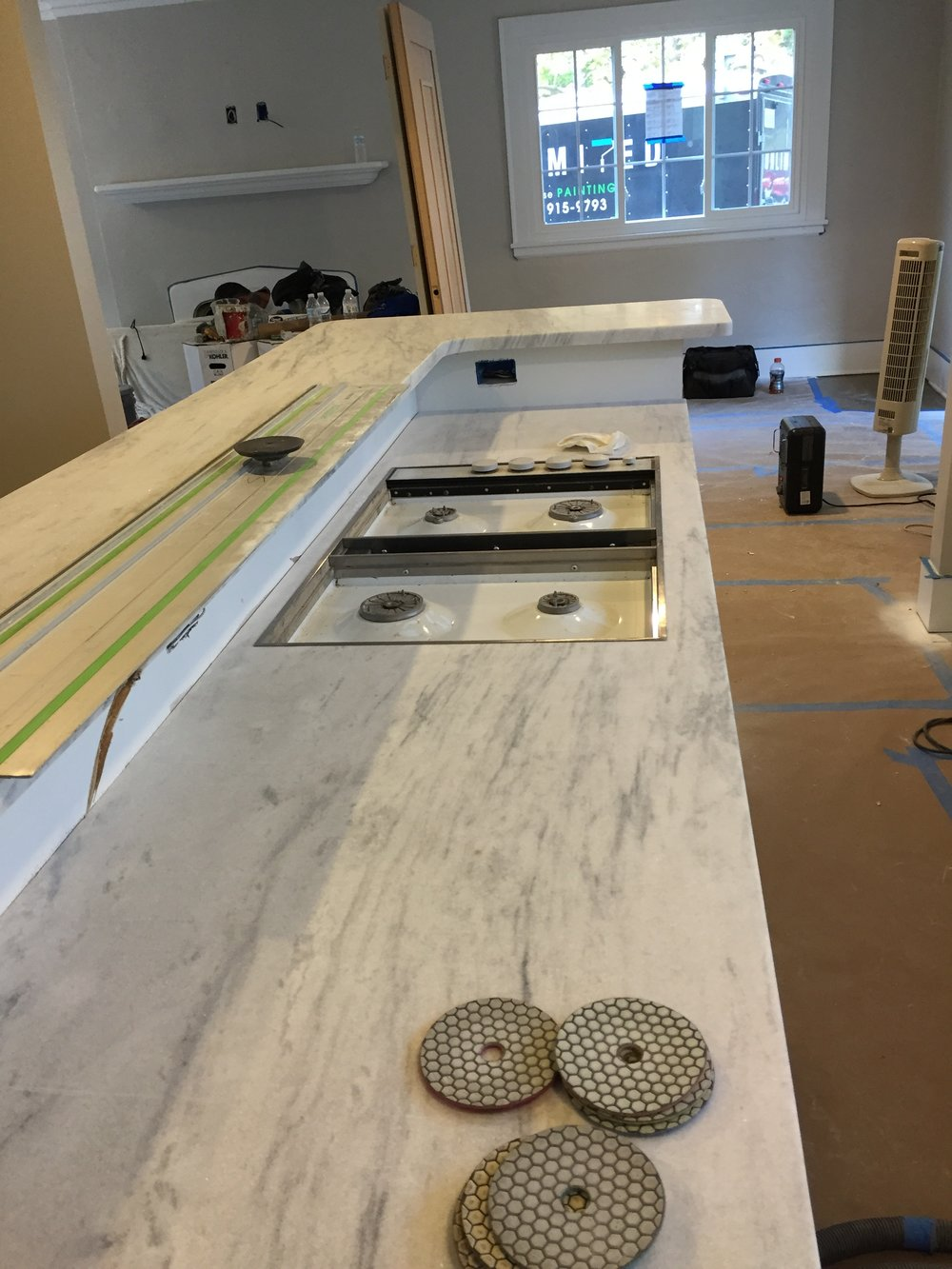During: Installing an island and honed marble countertop