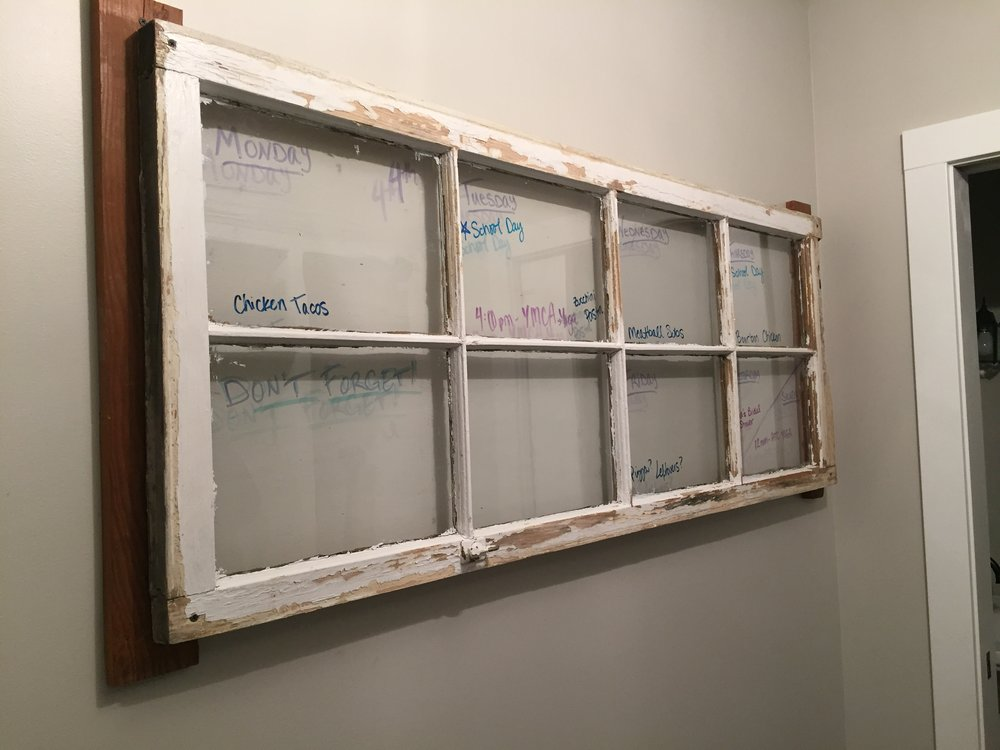 After: An original window repurposed as our family calendar