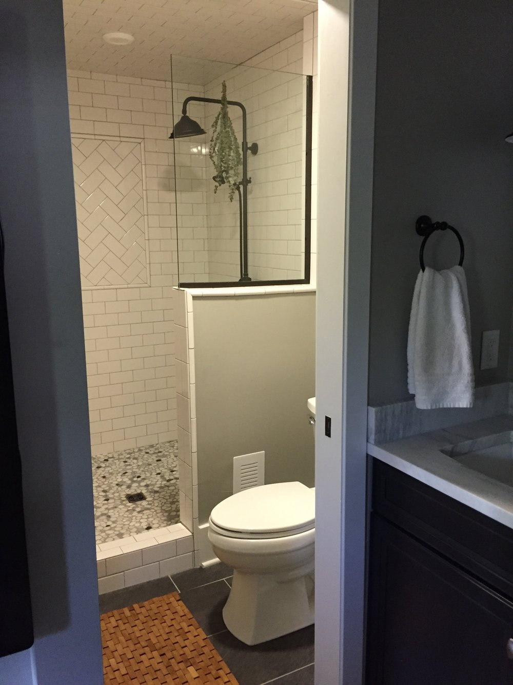 "After: ""Wet room"" with subway tile and natural stones in shower"