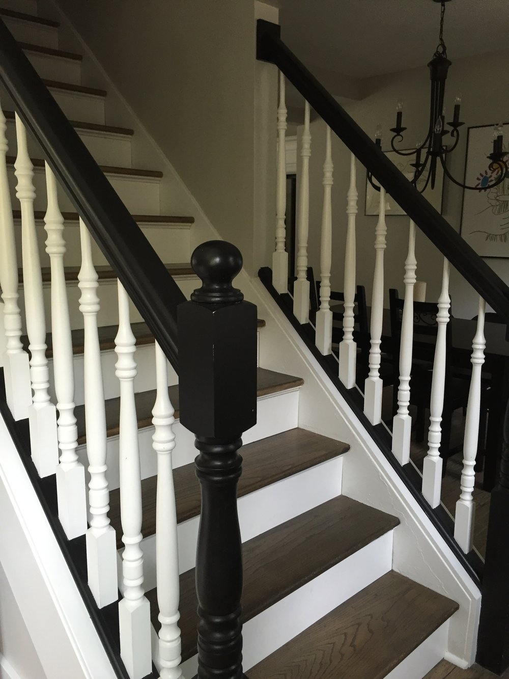 After: Enlarged opening and new banister for the stairs
