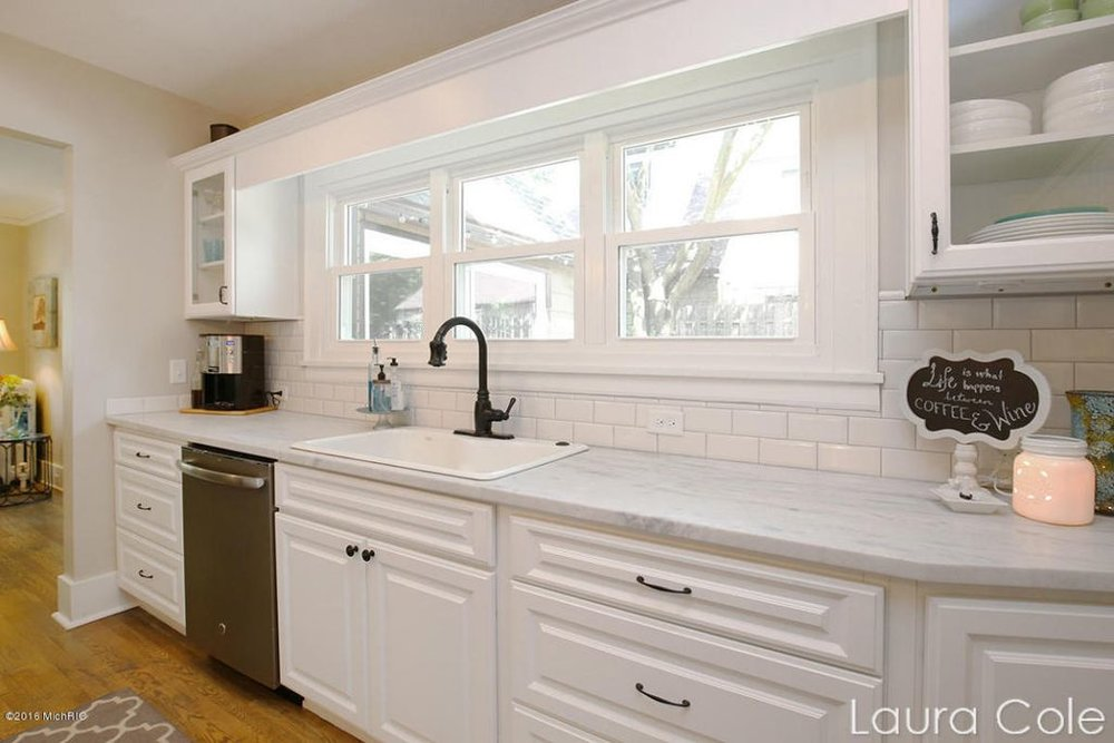 After: A farmhouse sink centered on the windows overlooking the deck