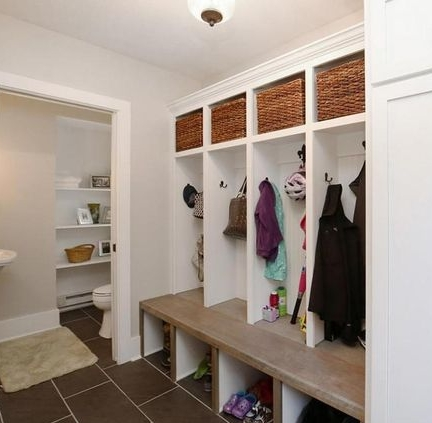 We now have a mudroom that perfectly meets the needs of our family.(This was originally a dysfunctional entrance to a poorly designed kitchen.) See the little shoes all tucked away? =)