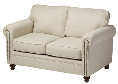 The  Caroll Loveseat  has comfy cushions, stylish turned feet (that's the term for when furniture feet have a shape, instead of just being square!), and nailhead trim. For housemates (like my husband) who aren't a fan of tufting- this a great compromise piece. It's marked down to less than $360 right now- watch for sales!