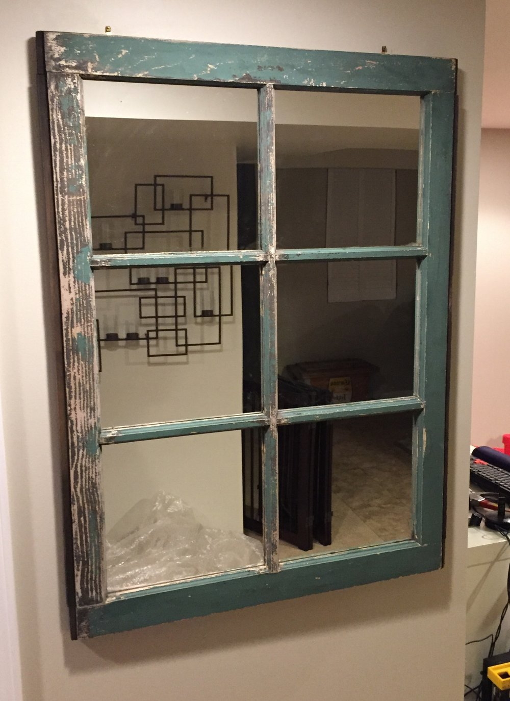 Michelle found this awesome window and turned it into the perfect mirror for her space.
