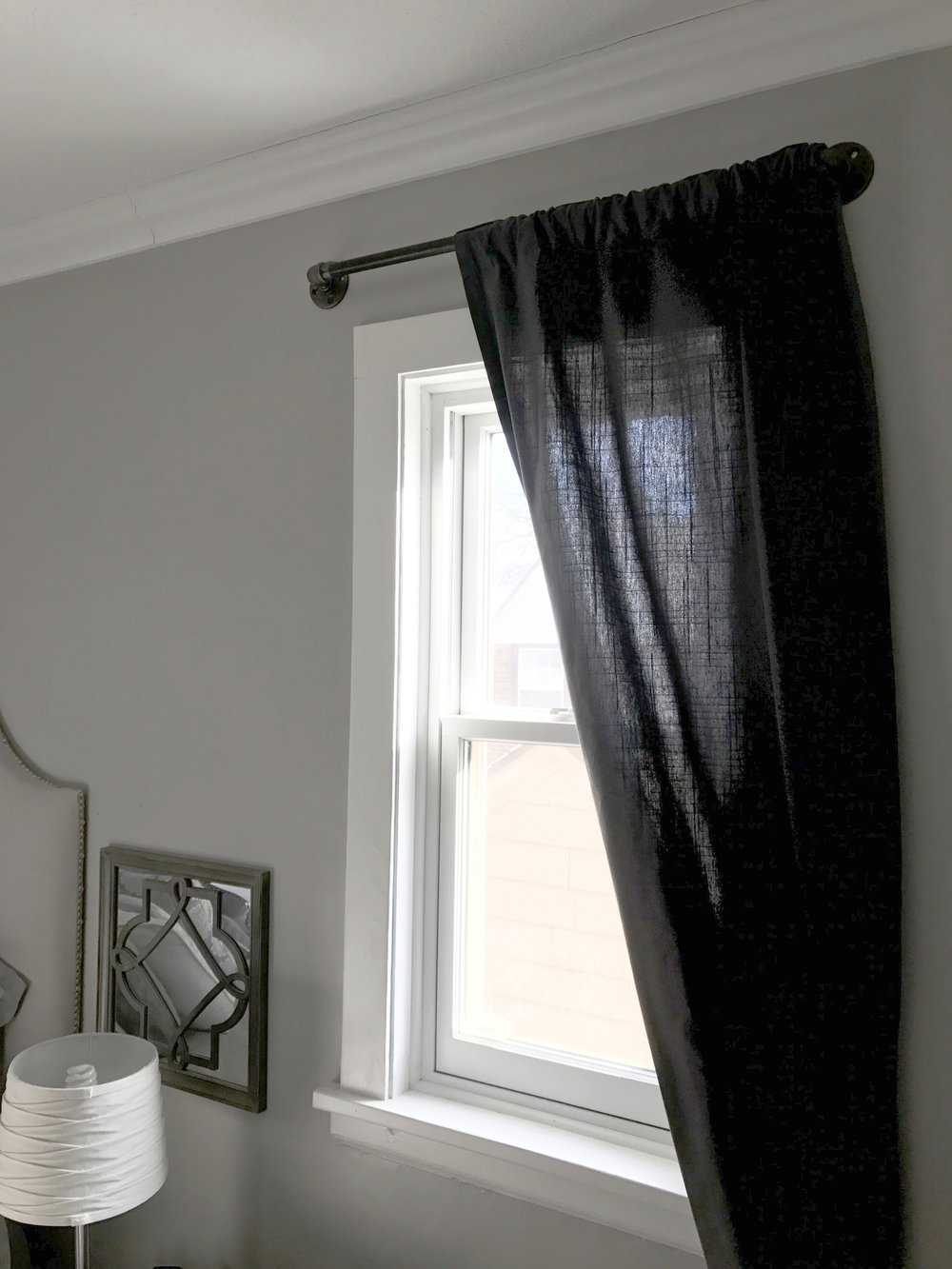 I love how these simple curtain rods add so much masculine industrial style.