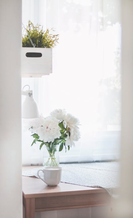 Small details like fresh flowers and light & bright window treatments help show off your space and make buyers feel at home.