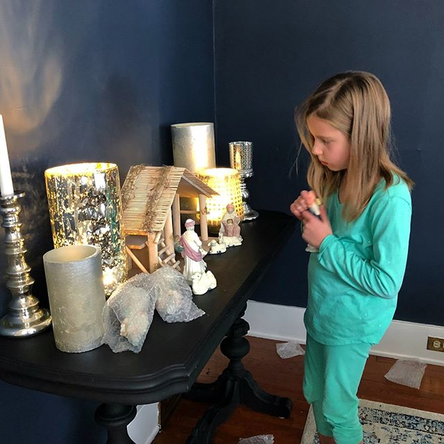 This sweet girl spent her snow day alternating between playing outside and helping me clean/ organize/ decorate. Not the Monday I had planned, but what a treat to share quiet moments like this with my oldest before she's too cool to set up the nativity with me anymore. ☺️ ❄️ #nativityscene #holidaydecorating #snowday #mamashelper #halenavydiningroom #halenavybenjaminmoore #diningroomdecor #thriftedhome #westmichigan #grandrapidsdesigner #mytradhome #navydiningroom #silvercandlesticks #theygrowupsofast #teachemyoung #productiveday #christmasdecorating