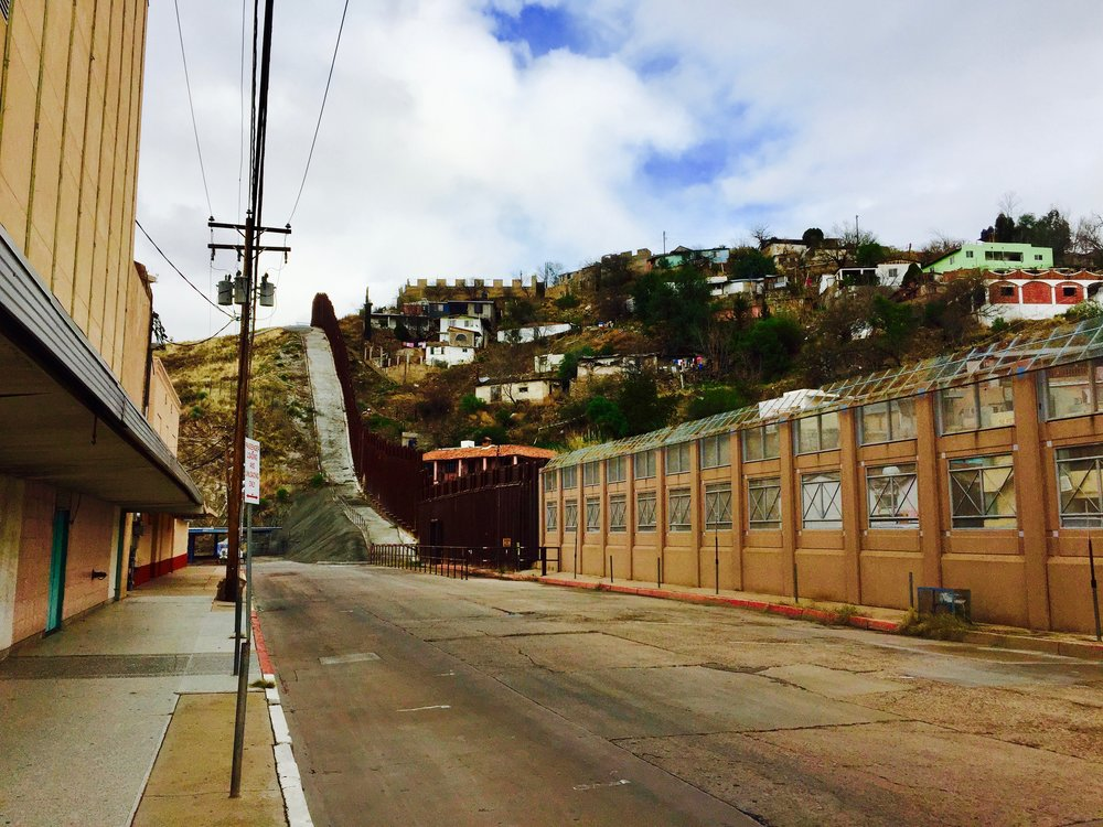 The current border wall, separating Nogales, AZ from Nogales, Sonora, Mexico on the right.