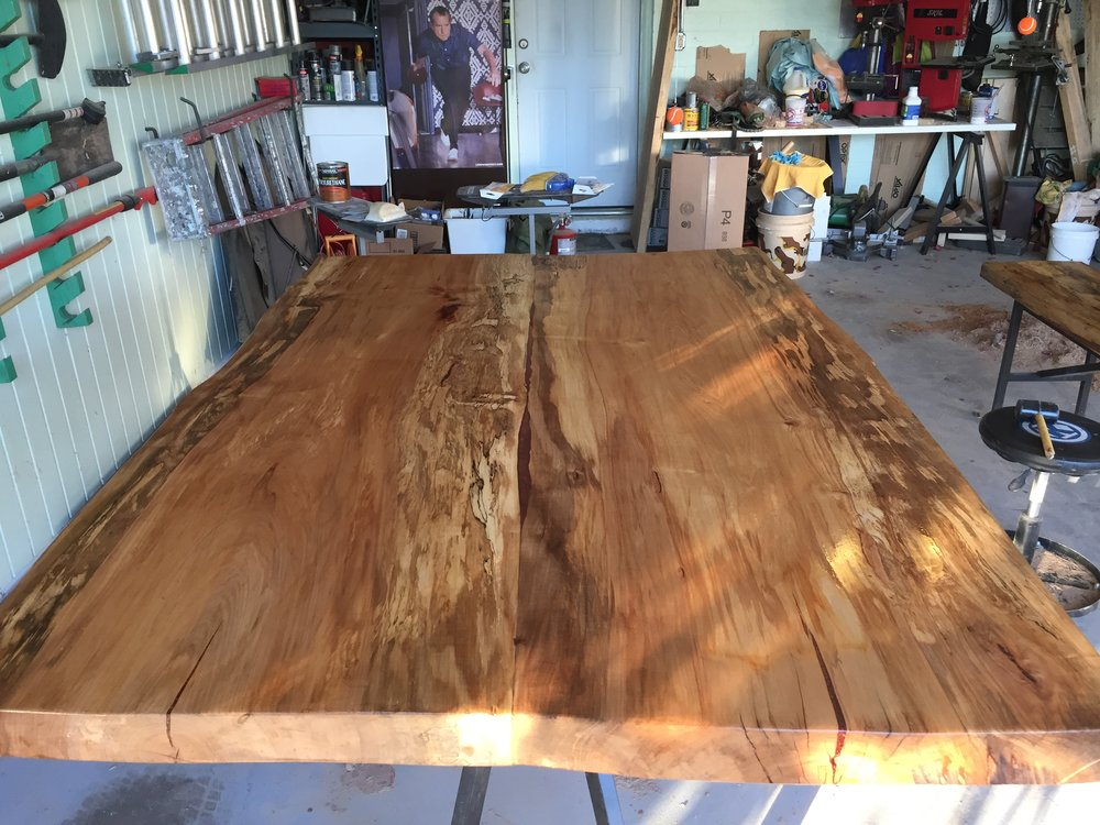 "Two mated slabs of spalted maple. The edges and center of the table top show the splating. The center of each slab shows the ""heart"" of the tree, where the maple grain remains largely unaffected by the fungus decay."