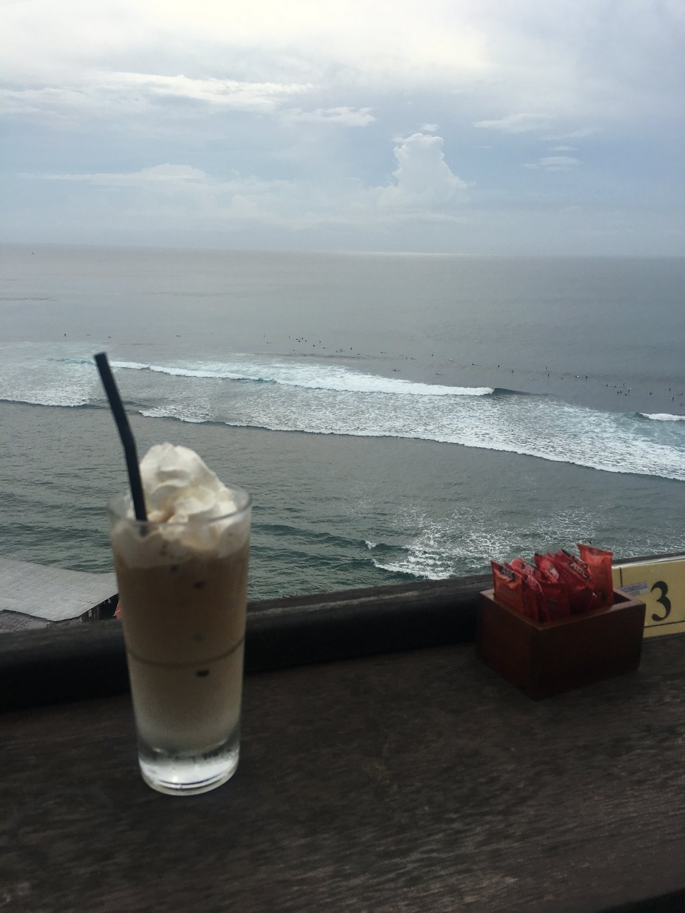 Overlooking the Uluwatu beach - the tiny dots in the ocean are surfers