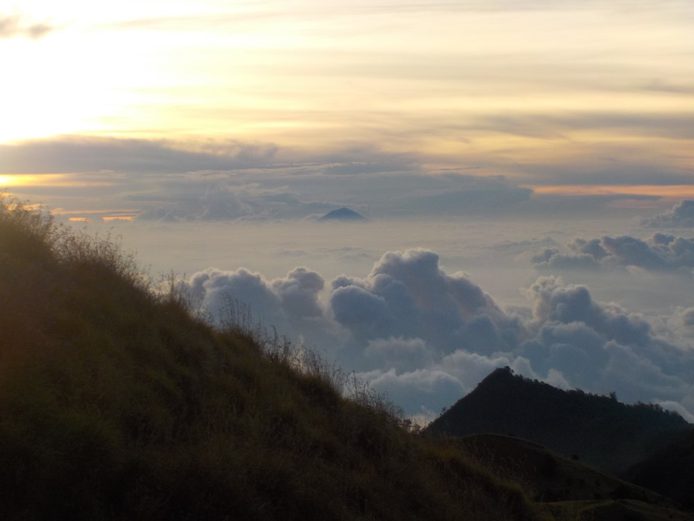 Looking west at dusk, night two. The peak is Mount Agung in Bali.