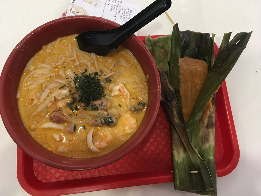 katong laksa, with a shrimp bar in a banana leaf