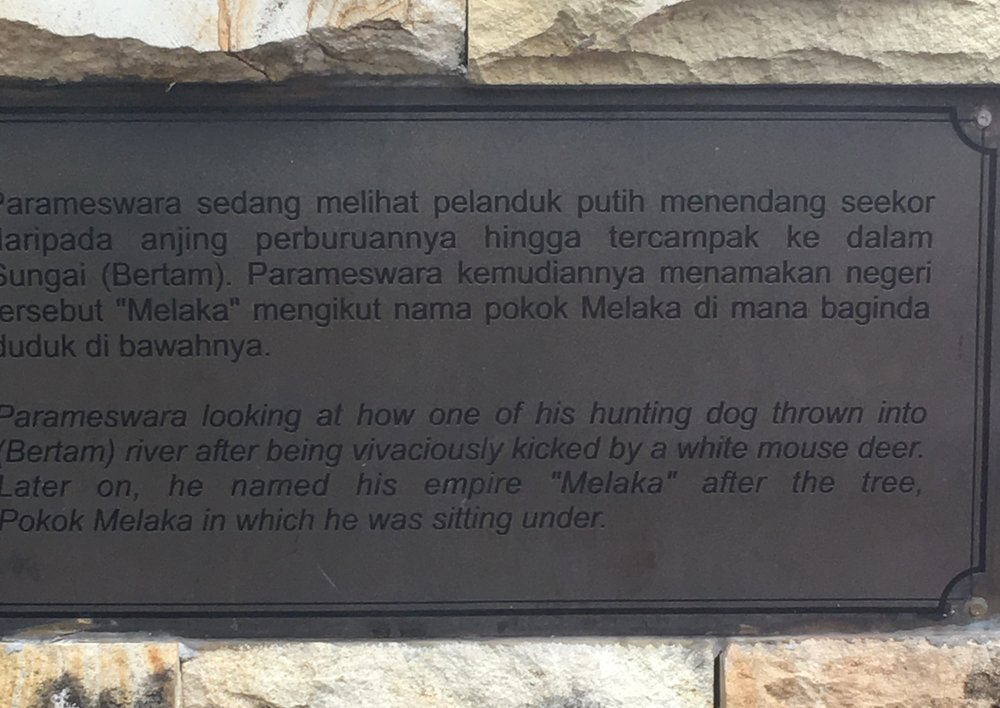 A plaque by the site of the malacca tree.