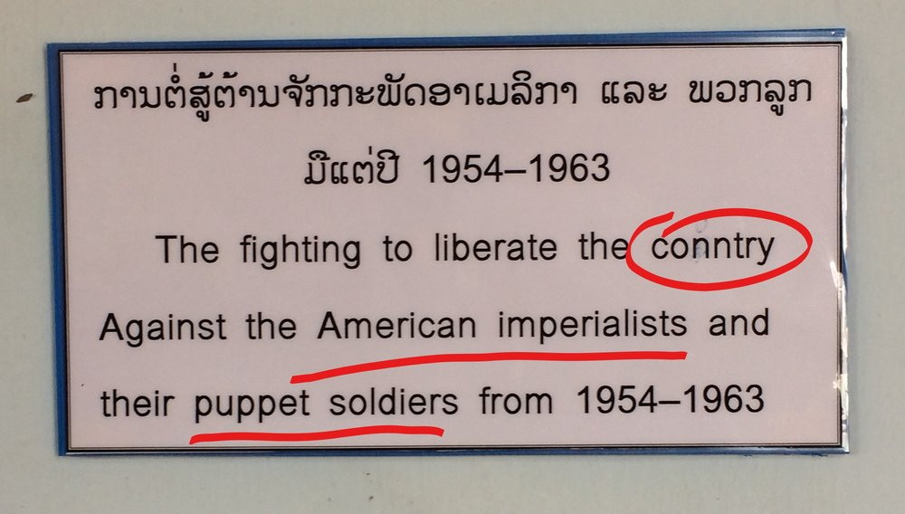 The National Museum of Laos, in the capital, Vientiane, has printed and laminated paper for descriptions of black and white photos. I wonder if they realized that the red lines in MS Word mean that there is a spelling error? Also, a different view on the US. Vientiane, Laos.