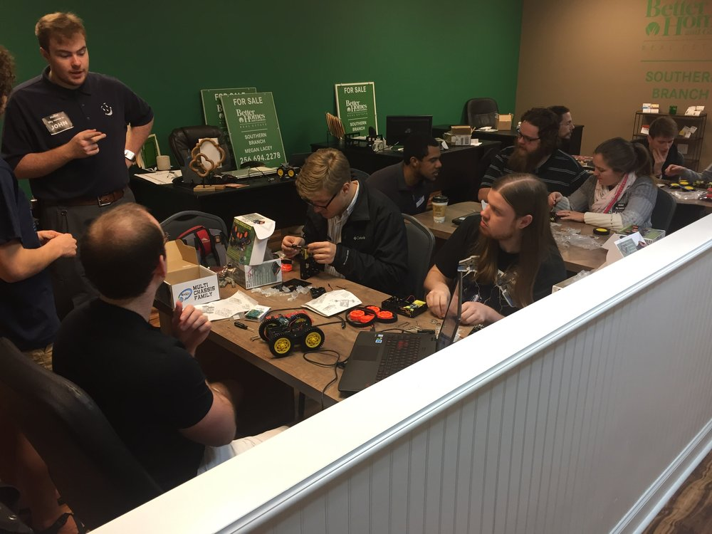 Members of the Hardware Hacking group build robots at CoWorking Night