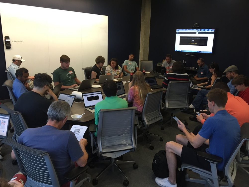 CoWorking Night members collaborate on a software project with local startup, Rock Paper Sold