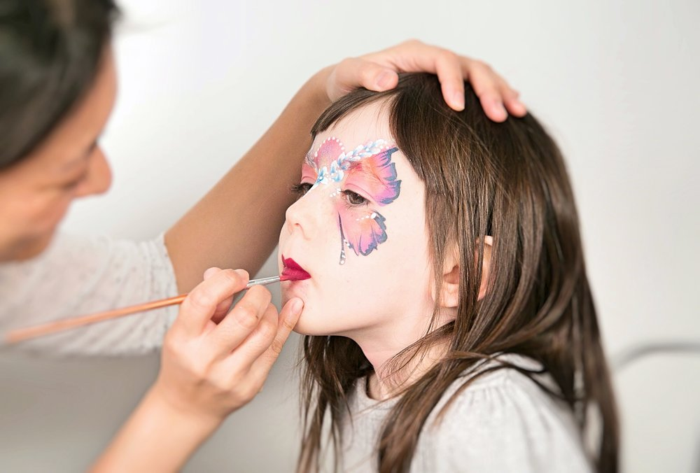 butterfly face painting in action
