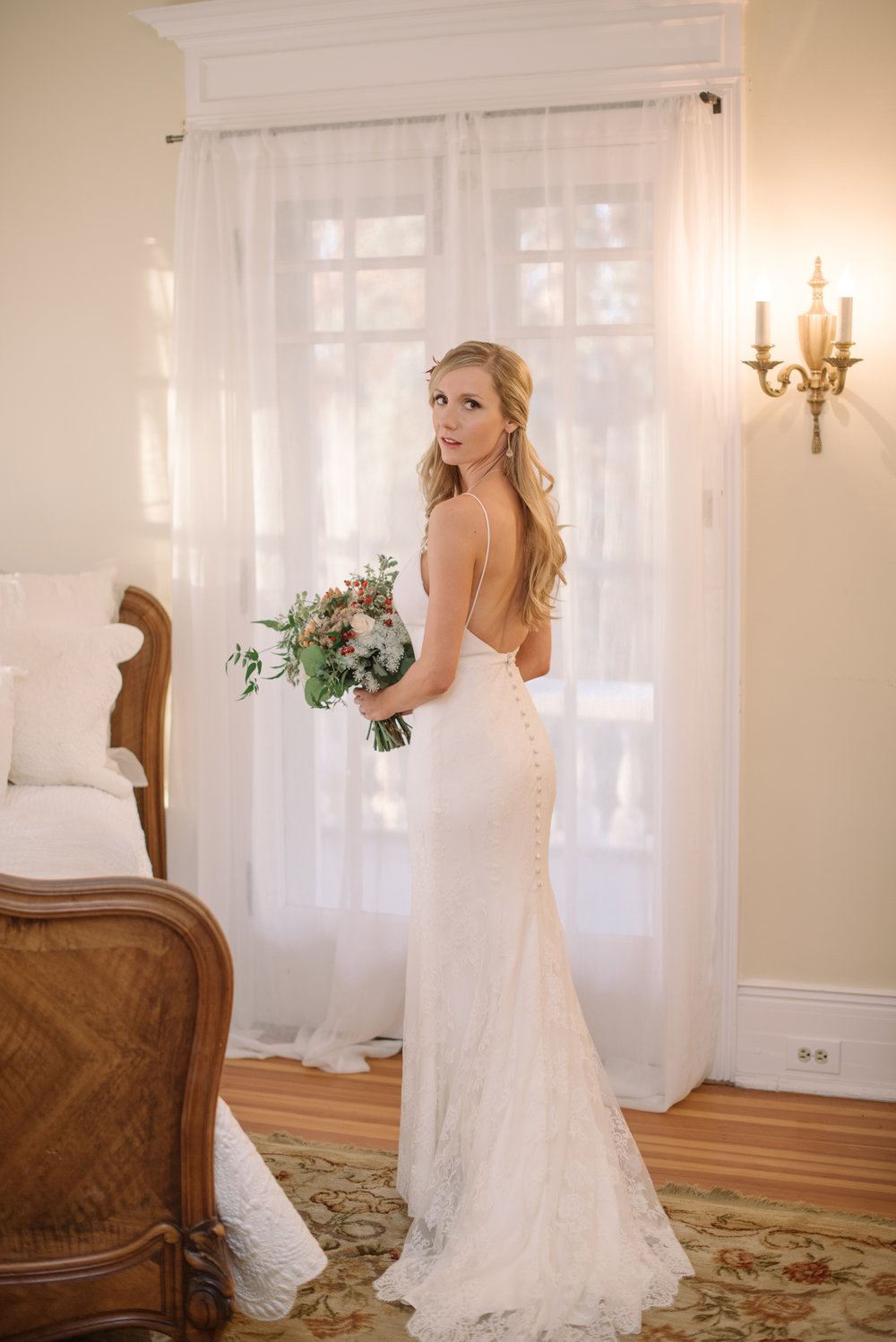 I love this photo because it has beautiful soft and warm light. There is still a lot of emotion, and yet in some ways it is also a classic bridal portrait. As an artist, I want to keep my viewer's eye on the image which is exactly what you get here.