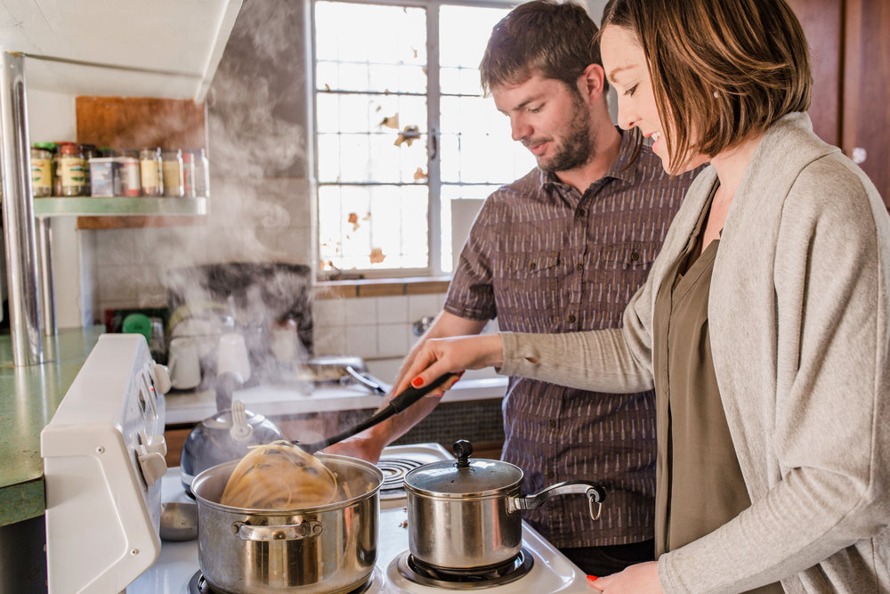Lifestyle_Engagement_Session_In_Home_Denver_006_cooking_couple_engagederny_photo_co_colorado_farm.jpg
