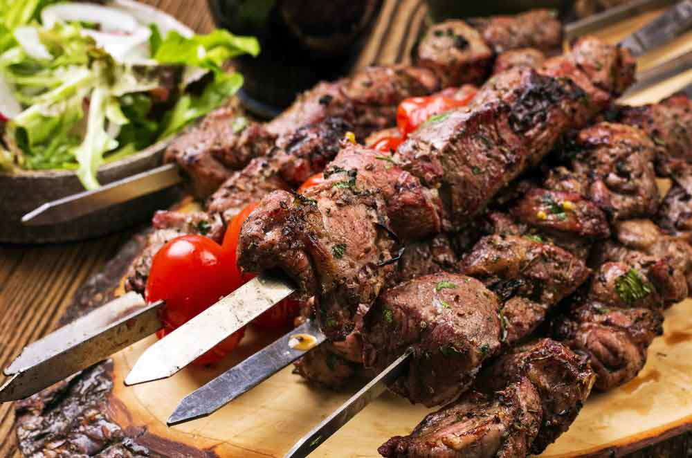 Souvlaki  a popular Greek fast food consisting of small pieces of meat grilled on a skewer