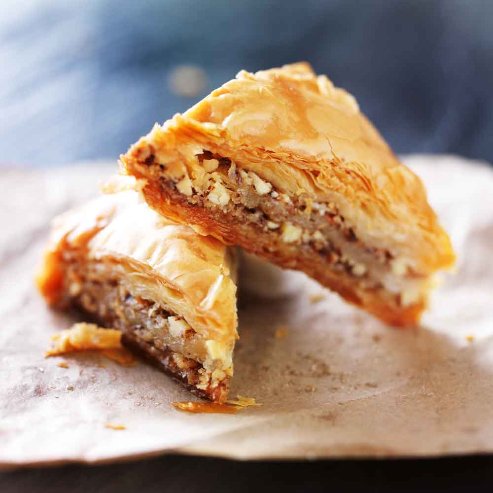 Baklava  a rich, sweet pastry made of layers of filo filled with chopped nuts and sweetened and held together with syrup or honey