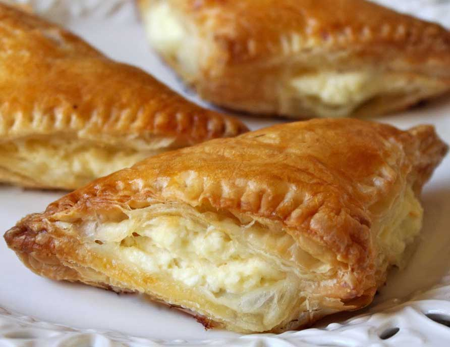 Tiropites  Greek layered pastry food in the burek family, made with layers of buttered phyllo and filled with a cheese-egg mixture