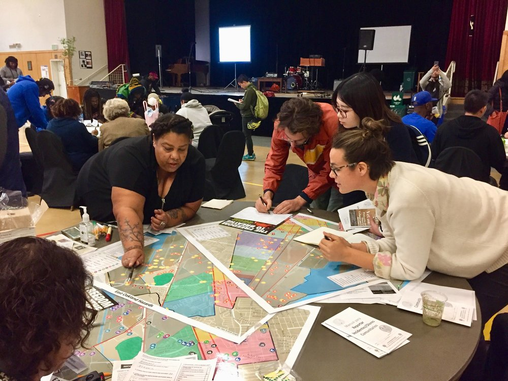 UC Berkeley students Julia Prince, Felix de Rosen, and Yitao Li participated in a community group discussion with their partner, the East Oakland Neighborhood Initiative, on Nov 10.