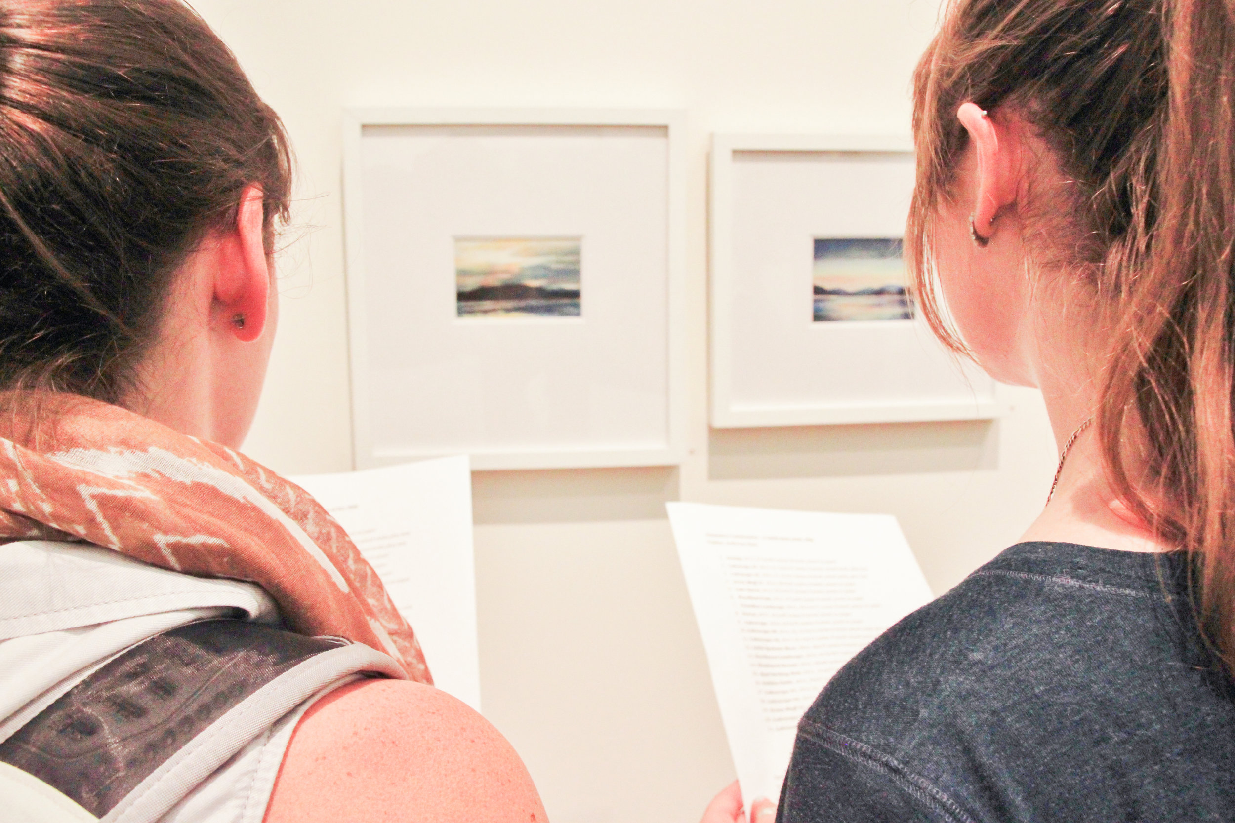 Students observe Northwest-inspired landscape artwork by Pauline Anderson Haas, a former Whitworth professor, in the Bryan Oliver Gallery. Rachel Anderson|Photographer