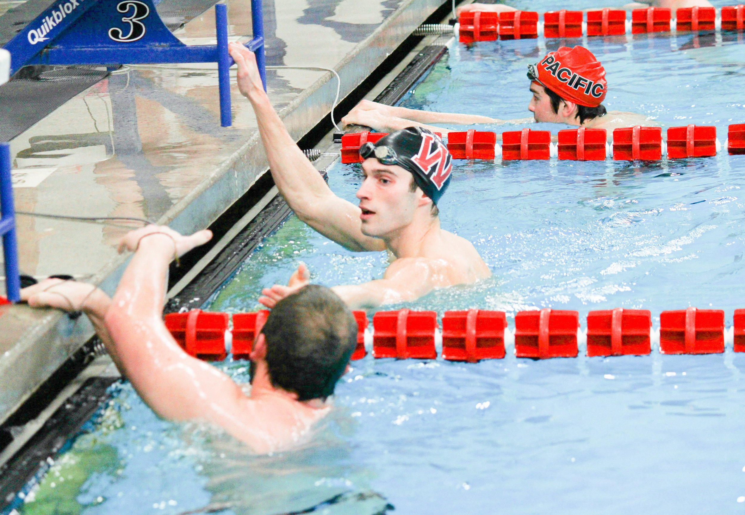 Sophomore Kyle Wicks shakes hands with a Pacific swimmer on Nov. 15. Hope Barnes|File Photo