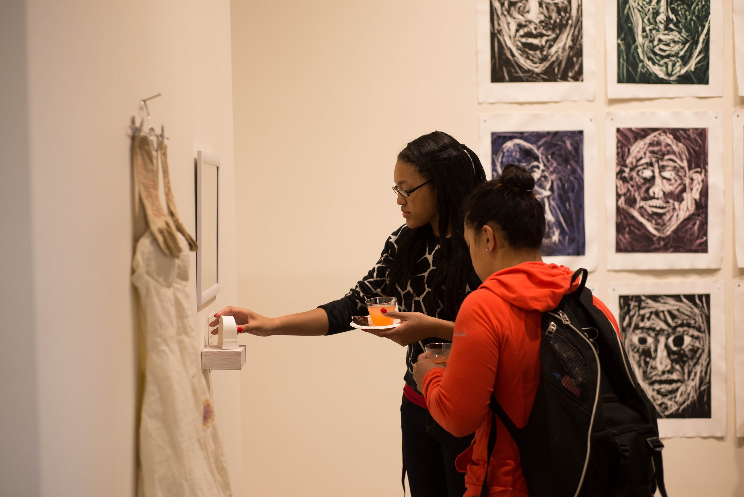 "Freshman Jira Hammond interprets senior Annie Feuerstein's piece titled ""Set Time, Face Self""."