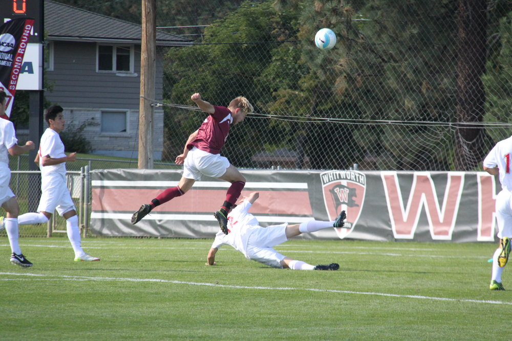 Kelly Logie|Photography Editor Sophomore Christian Haas goes up for a ball against Linfield Sunday afternoon.