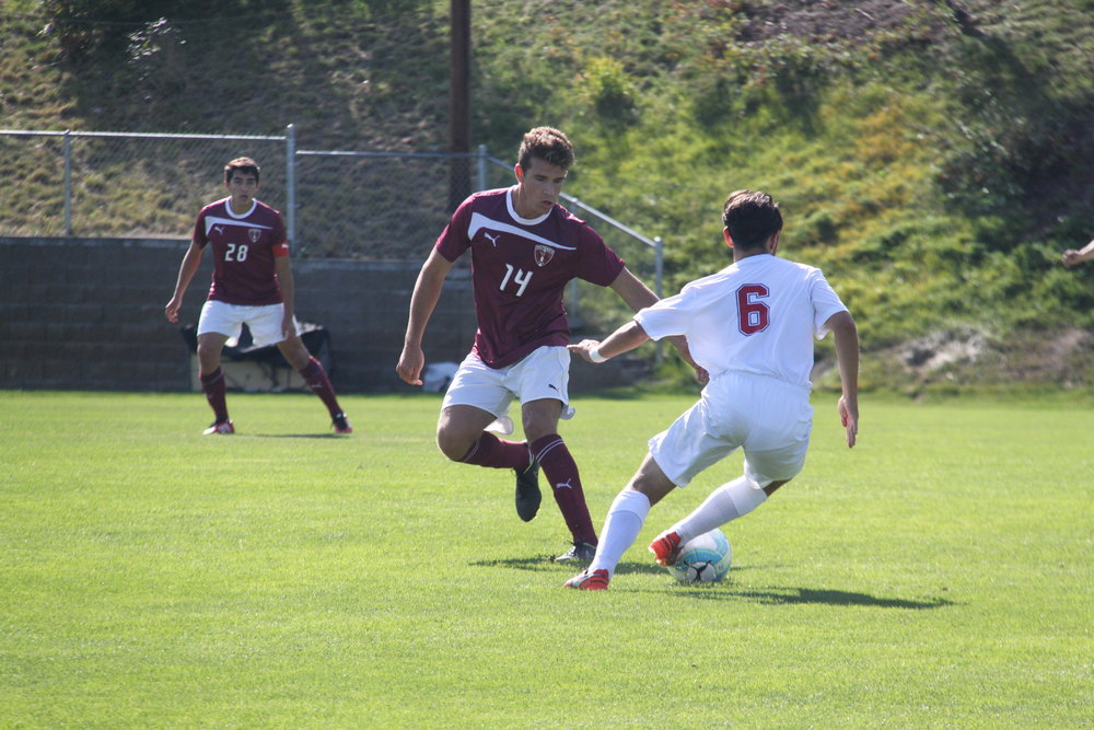 Kelly Logie|Photography Editor Sophomore Sam McKay attempts to juke a defender Sunday afternoon against Linfield.