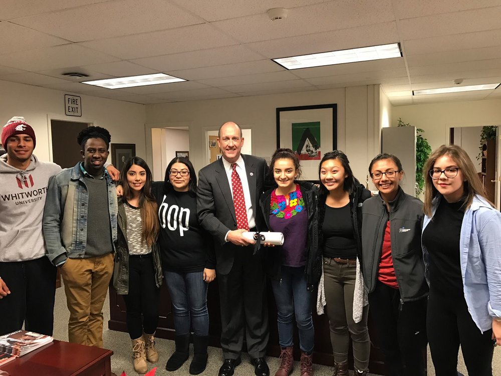 President Beck Taylor poses with students who entered his office with a petition proposing that Whitworth become a sanctuary campus. Photograph courtesy of Beck Taylor.