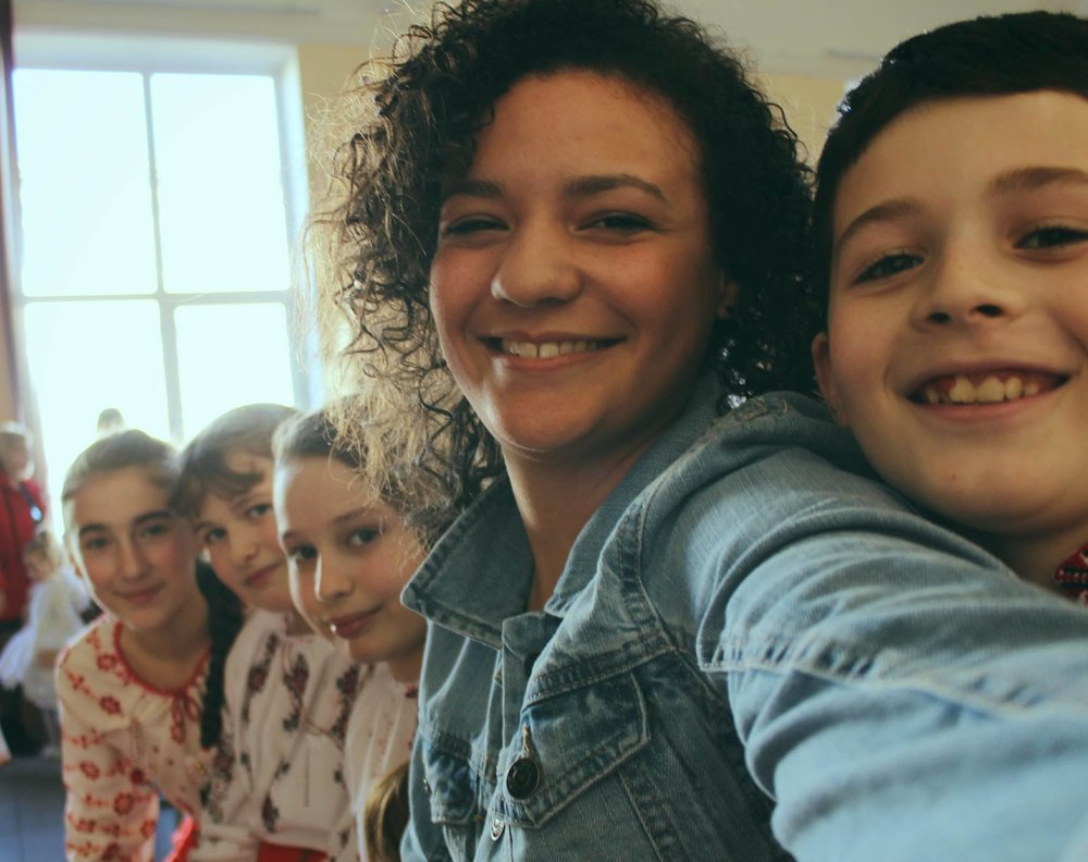 Whitney Carter, class of 2016, takes a selfie with the children she teaches in Ukraine. Photo courtesy of Whitney Carter.