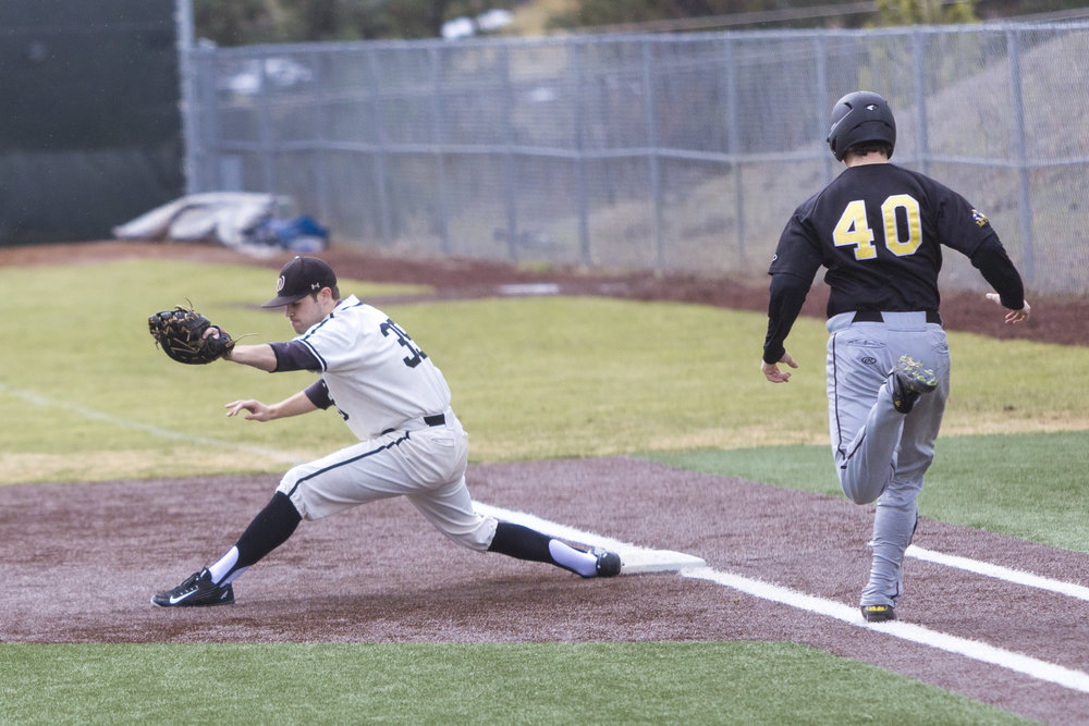Matt Nelson, '17, stretches to make the play, retiring PLU's Cole Johnson at first (Hannah Brekke | Photographer).