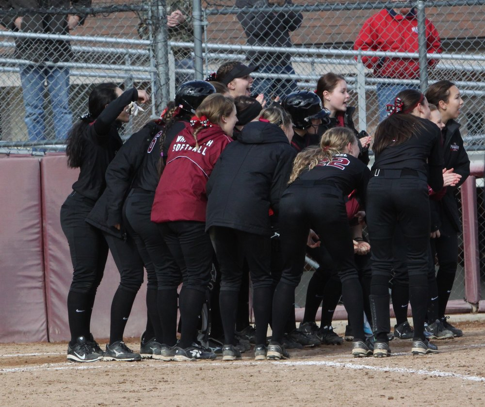 The Pirates celebrate at home plate during a game last season. This weekend, the Bucs swept Lewis & Clark in Portland. (Zoe Koch | Photographer)