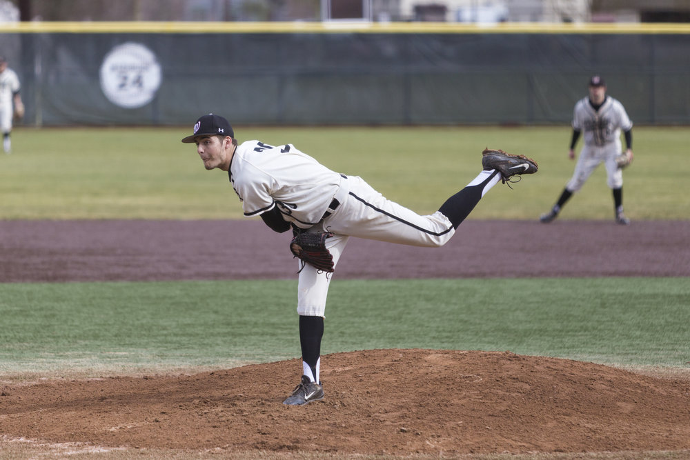 Ryan Kingma pitches against PLU on March 18. Kingma threw 5.2 innings and gave up just three runs in a 4-1 loss to UPS on Saturday. (Hannah Brekke | Photographer)