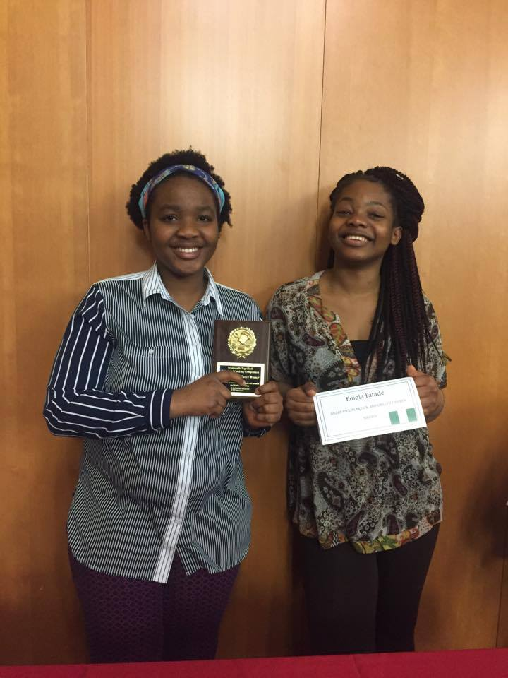 Nigerian chefs Eniola Fatade and Auobami Adedeji pose with their people's choice award April 9.