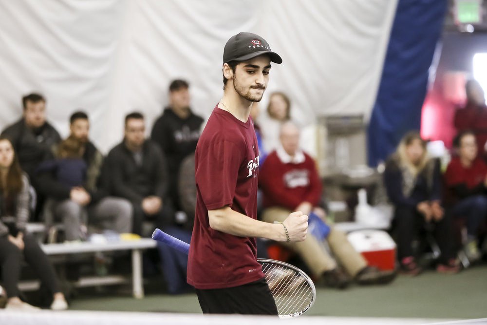 Jeffery Vulis, '17, celebrates a victory earlier in the season. Vulis finished out his season with a win last weekend.