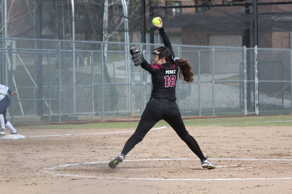 Madi Perez, '17, is among the leaders in several national pitching statistics. Here, she pitches against George Fox during a game last season. The Bruins will be the Bucs' first opponent in the Northwest Conference Tournament. (Zoe Koch | Photographer)